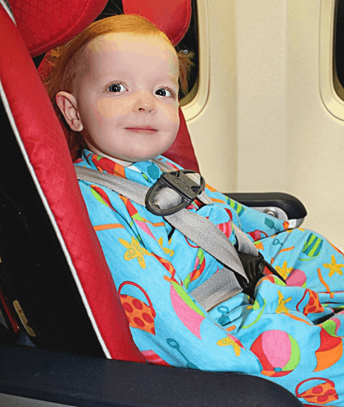 The Best Flying With Kids Hacks - baby on airplane