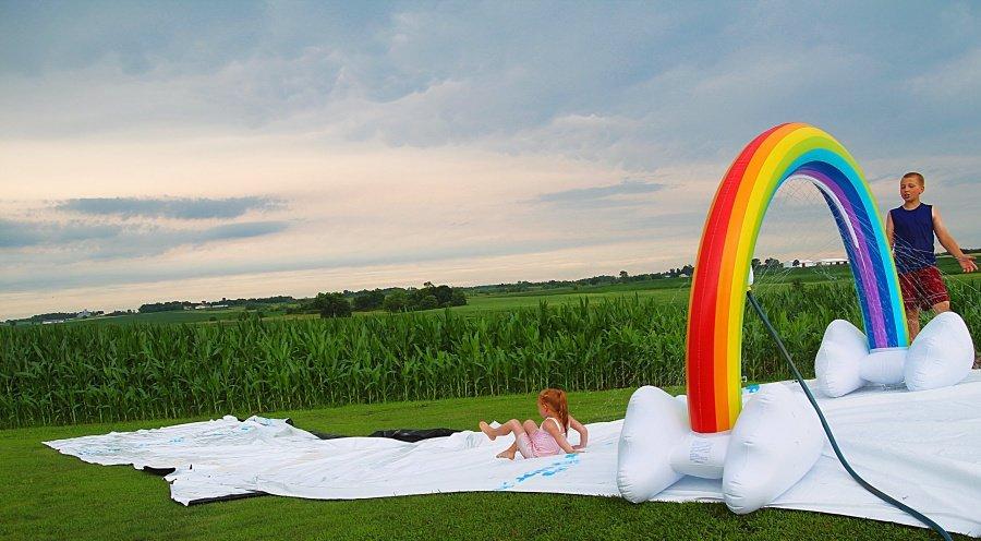 25 Affordable Or Free Kids Activities For Your Backyard - Rainbow Giant Sprinkler + Homemade slip n slide