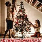 Child placing ornament on a tree - The Best Gifts for Toddlers