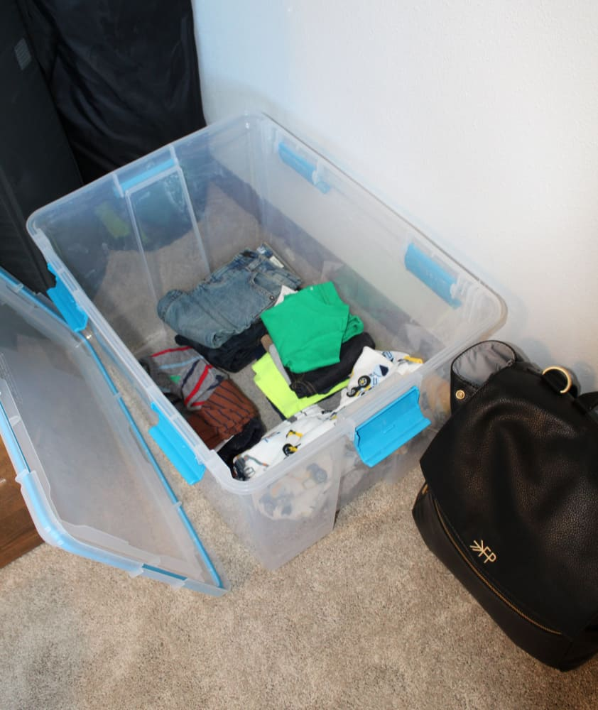 tote in bottom of baby's closet