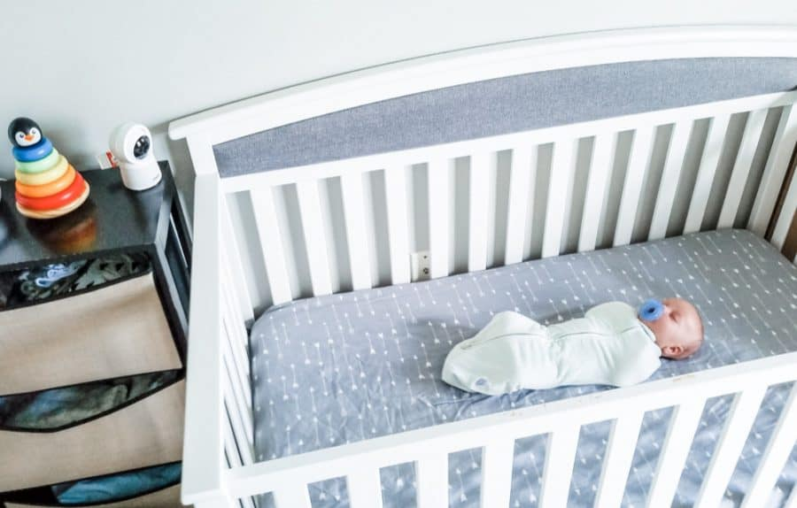 baby in crib with vtech baby monitor