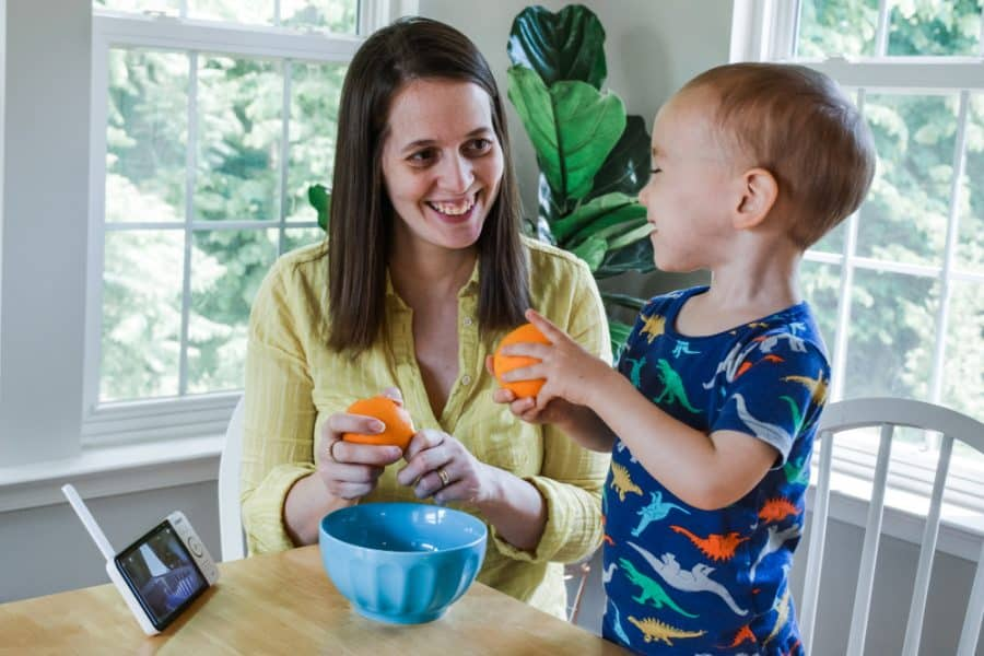 mom and son eating oranges