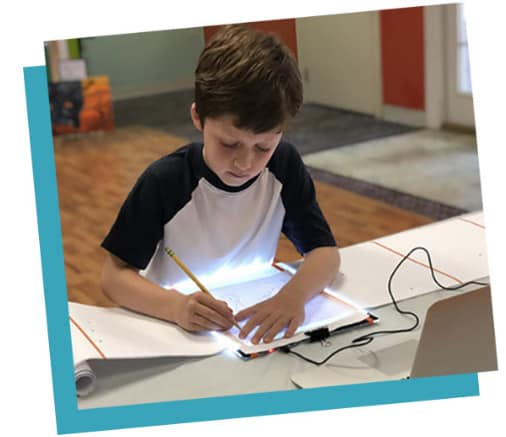 boy drawing - Self Care During Isolation + Fun Ideas, Toys, And Activities For Kids