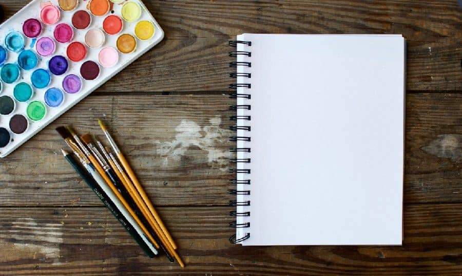 notebook, paints, and brushes - 12 Simple Ways To Love Yourself As A Mom