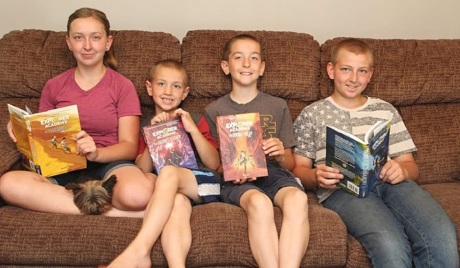 Kids with books - Awesome Adventure Chapter Books For Kids + More Nat Geo Must Haves!