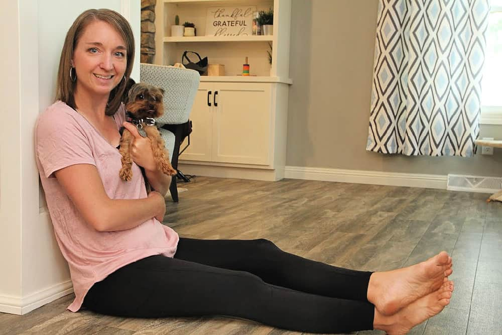 Woman holding dog - Nadine West - The Affordable Outfit Subscription