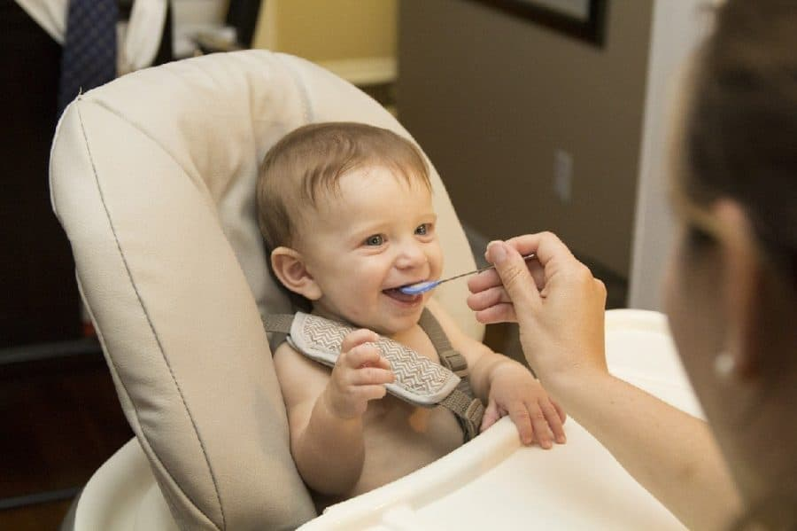 baby in highchair - Preventing Childhood Food Allergies [With Ready, Set, Food!]