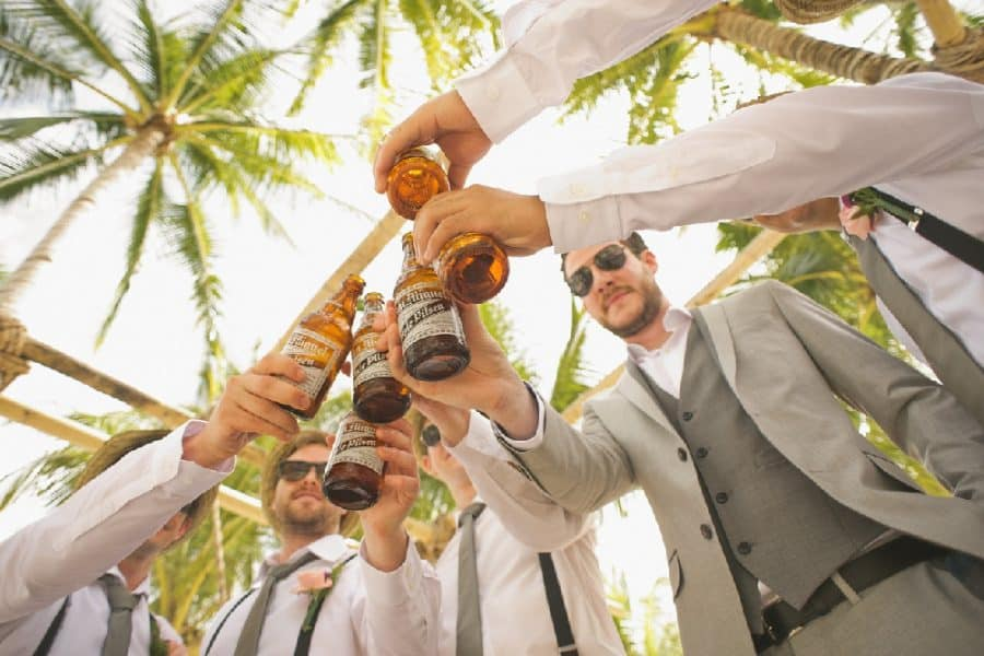Group of men raising a cheers - The Ultimate Man Cave - Top 10 Things You Need!