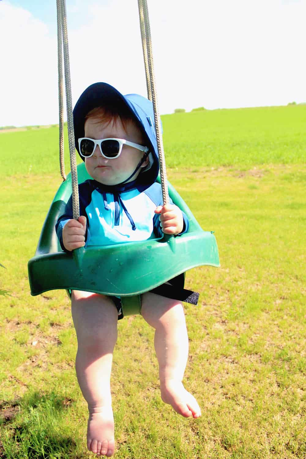 green sprouts baby on swing