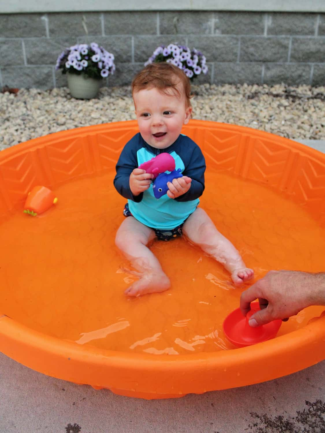 Green Sprouts Baby in pool