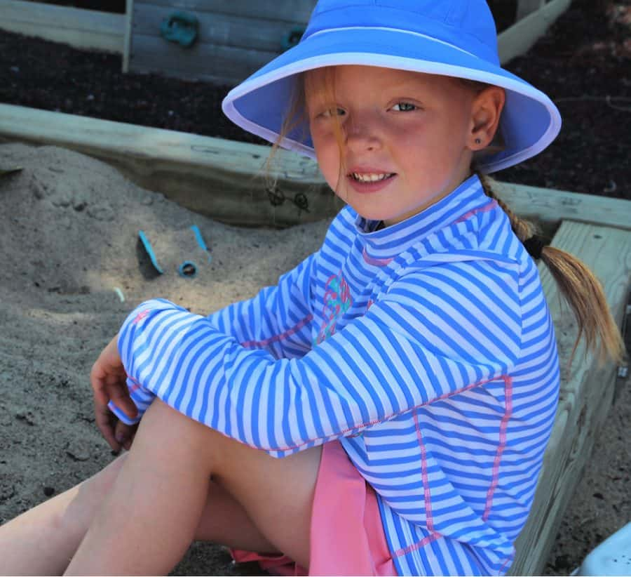 girl in sand - Alex (wearing Kid's LumaLeo Hoodie UPF 50+ & Boy's Outpace Sport Shorts UPF 50+),