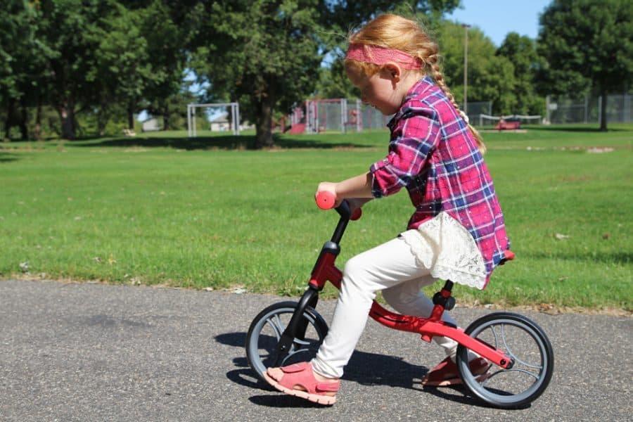 girl on bike - Globber Balance Bike