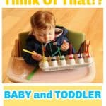 toddler in highchair with homemade popsicle toy
