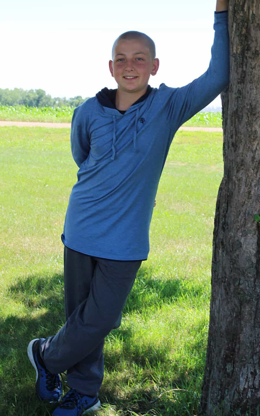 boy by tree - Sun And Water Safety Tips - Keeping Kids Safe