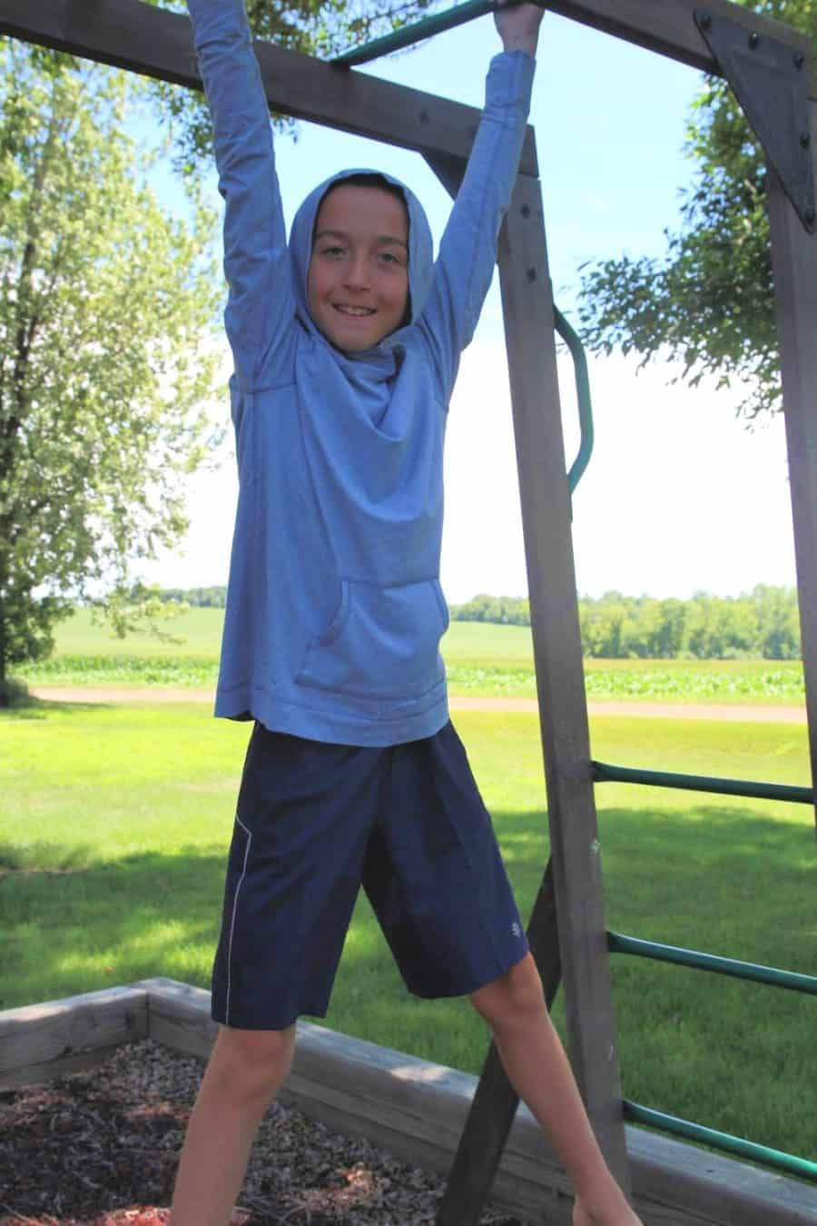 Boy on monkey bars - Sun And Water Safety Tips - Keeping Kids Safe