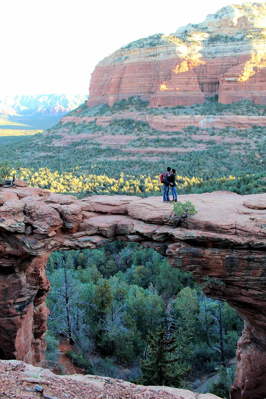 man and women on cliff bridge