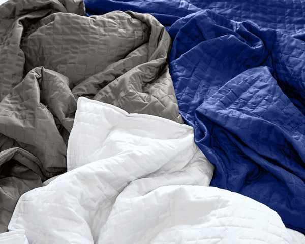 white, grey and blue blanket