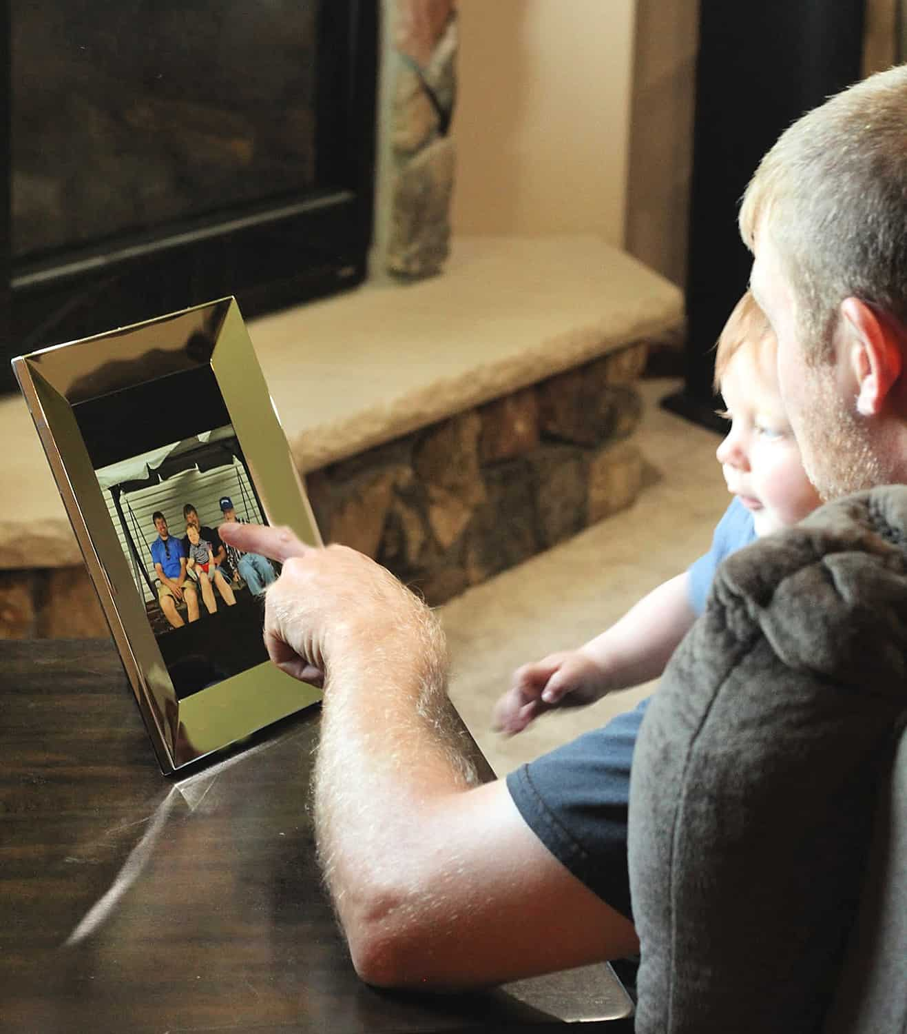 father and son looking at photo frame