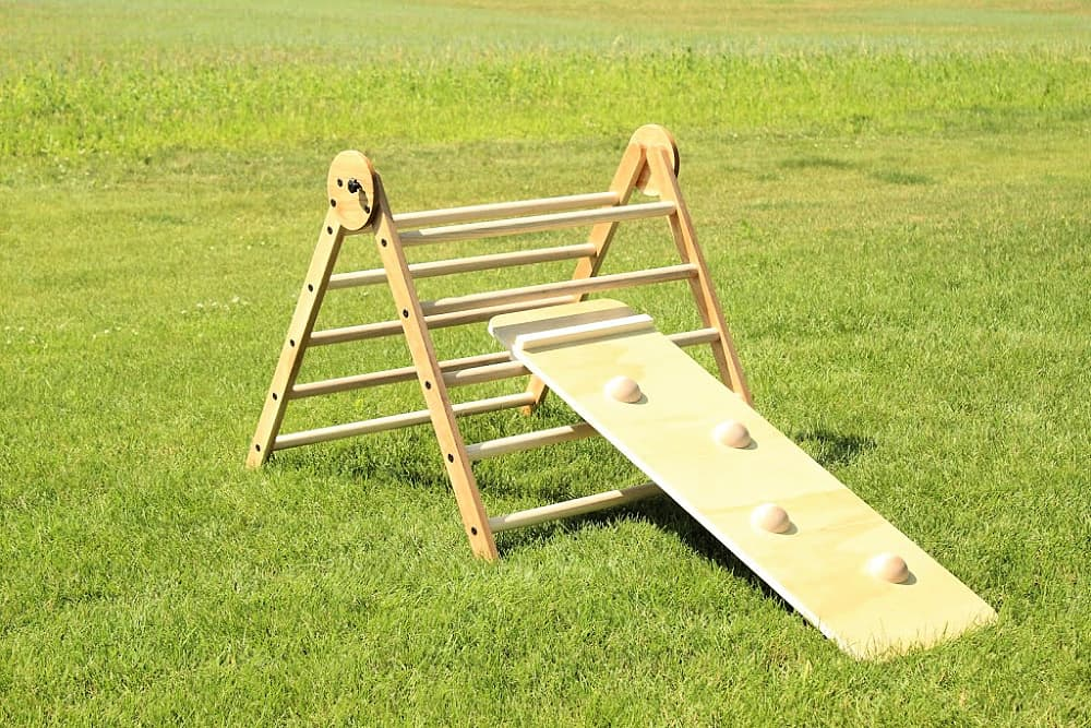 wooden climbing triangle with slide