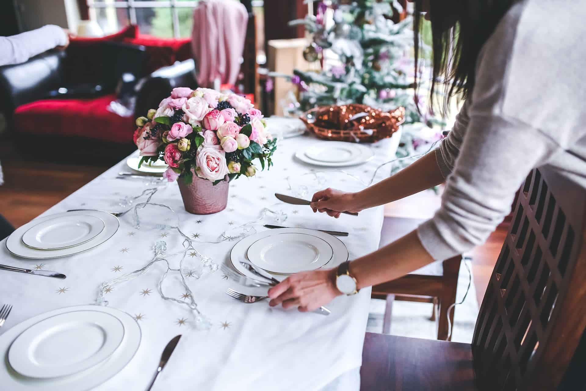 women's arms setting the table