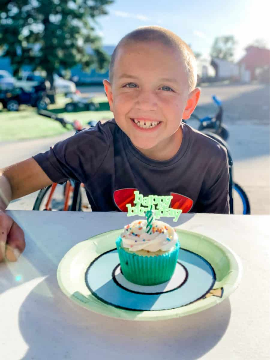 boy with cupcake - 13+ Best Frugal And Free Ways To Celebrate Birthdays