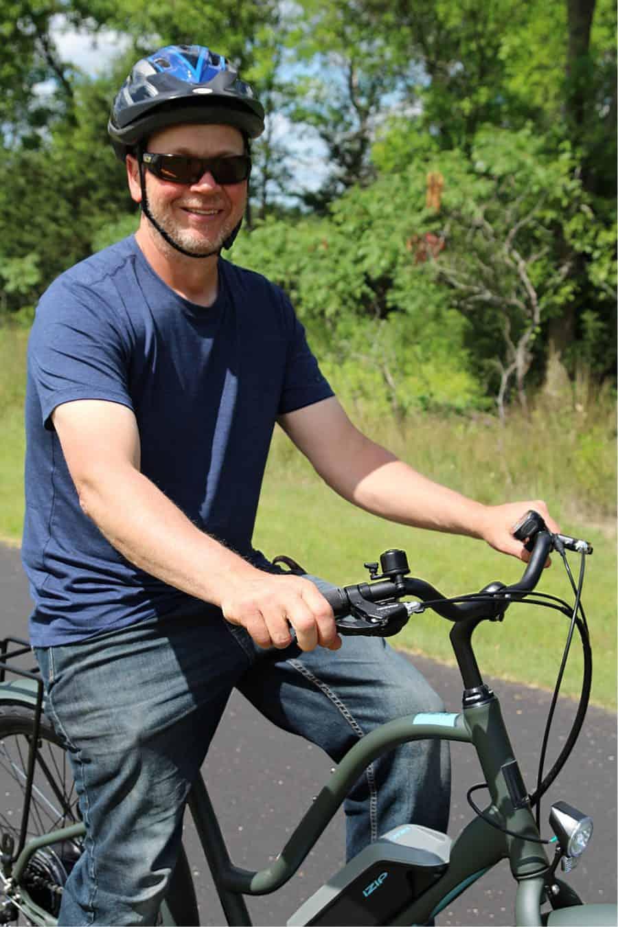 man on bike - Beginners Guide To Family Biking - iZip Simi Step Through Electric Bike