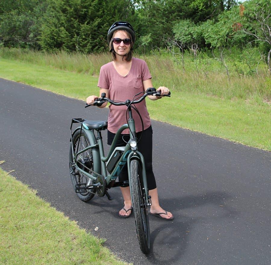 girl on bike - Beginners Guide To Family Biking - iZip Simi Step Through Electric Bike