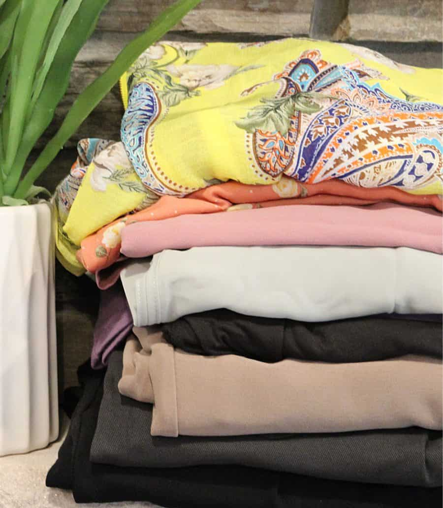 pile of clothes - Cheapest Clothing Subscription Option - A Nadine West Review