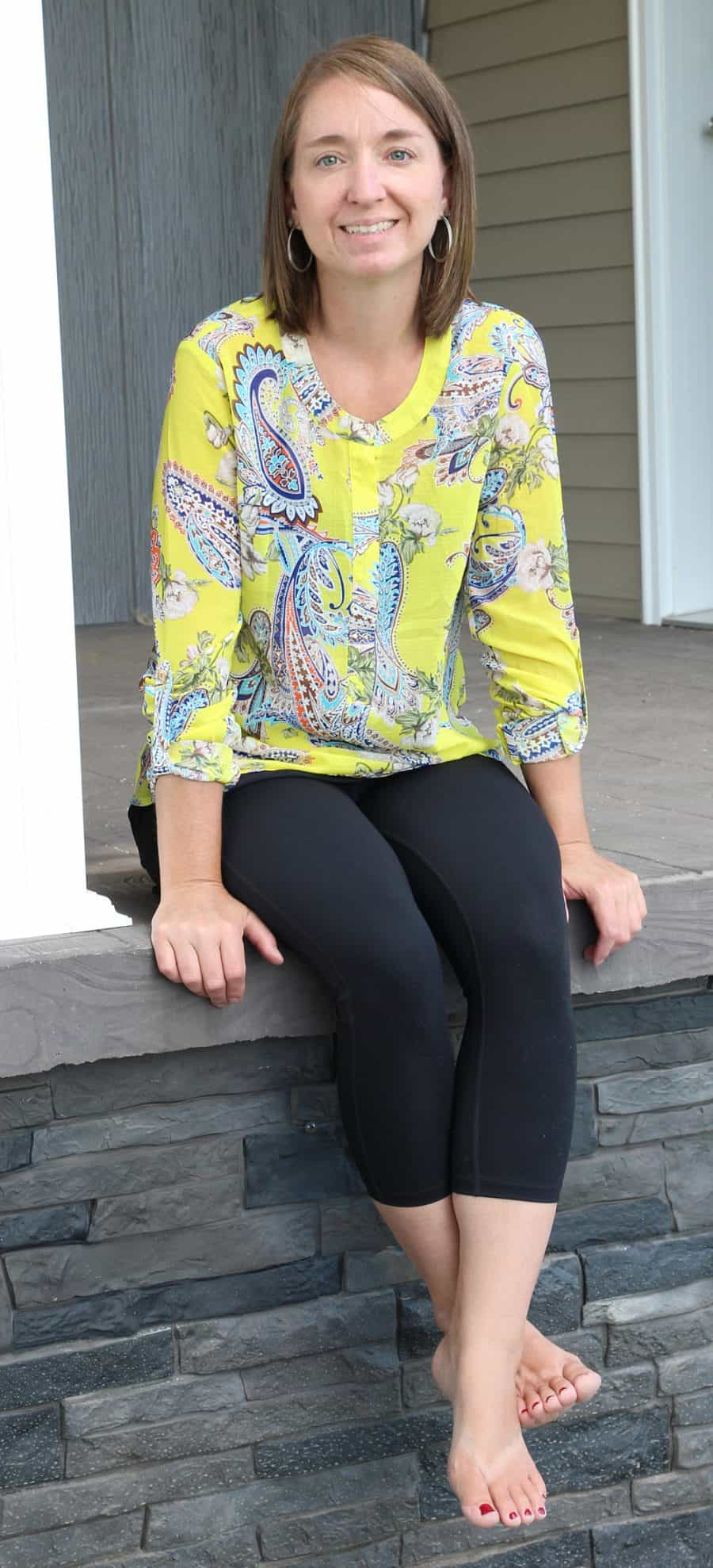 woman sitting on porch - Cheapest Clothing Subscription Option - A Nadine West Review