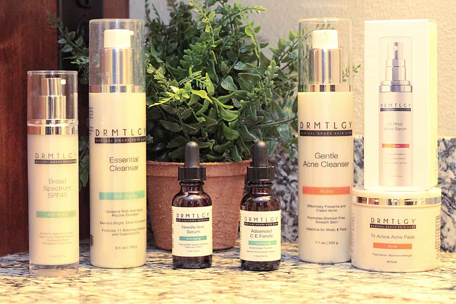 7 bottles of DRMTLGY face products