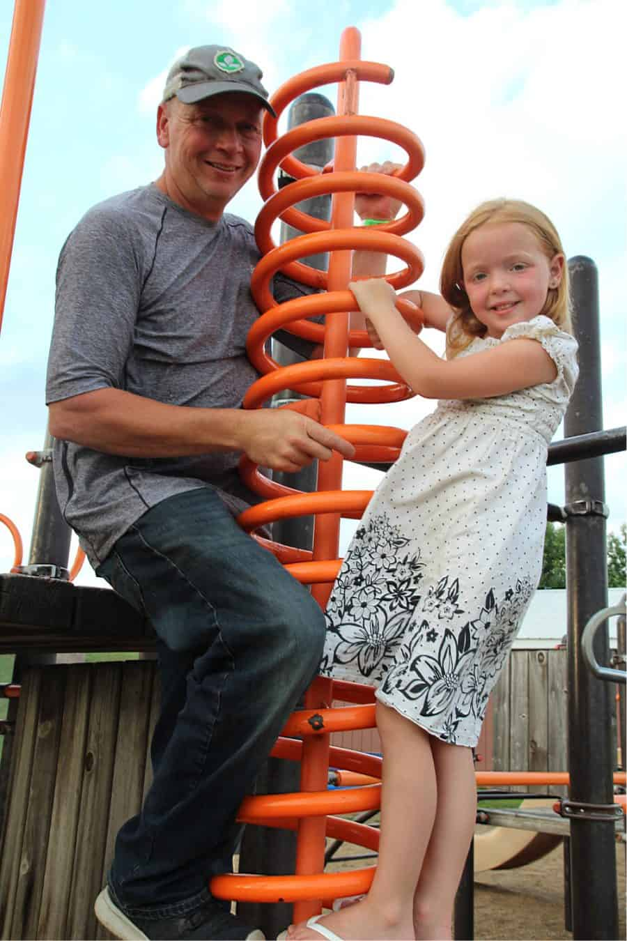 dad and daughter on playground - Jellystone - Top 10 Things To Do In Sioux Falls + The Best Place To Stay!