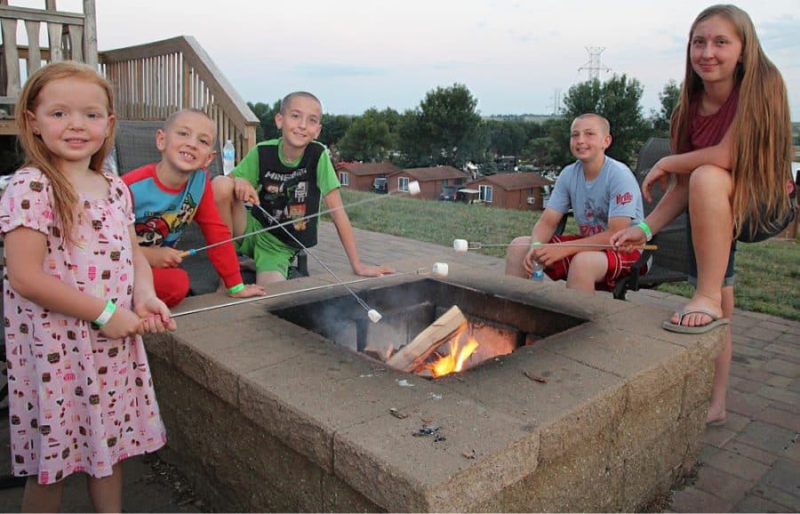 kids around a campfire - Jellystone - Top 10 Things To Do In Sioux Falls + The Best Place To Stay!