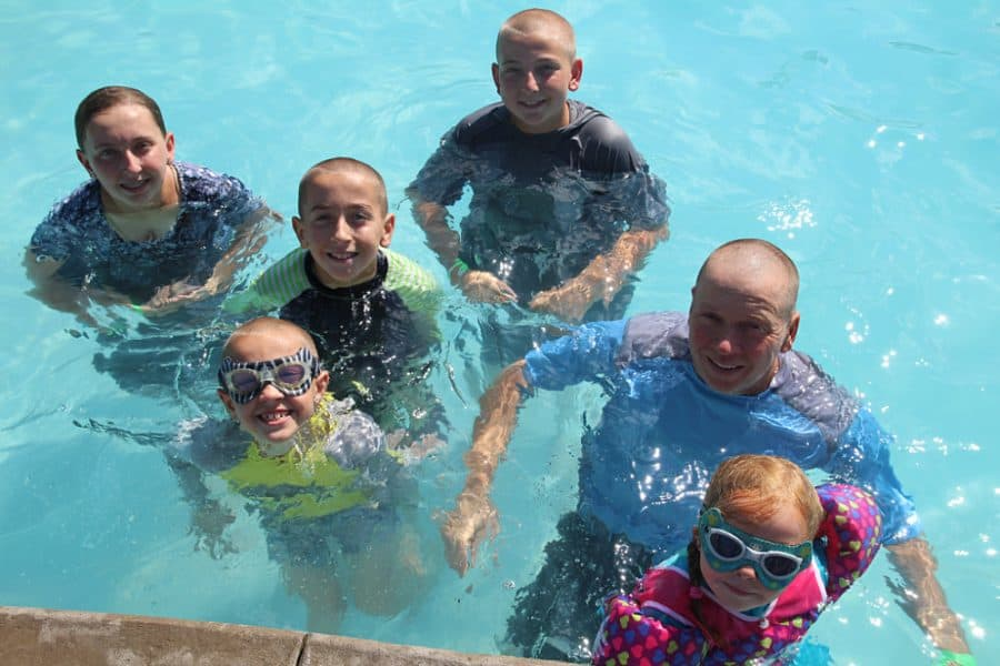family in pool - Jellystone - Top 10 Things To Do In Sioux Falls + The Best Place To Stay!