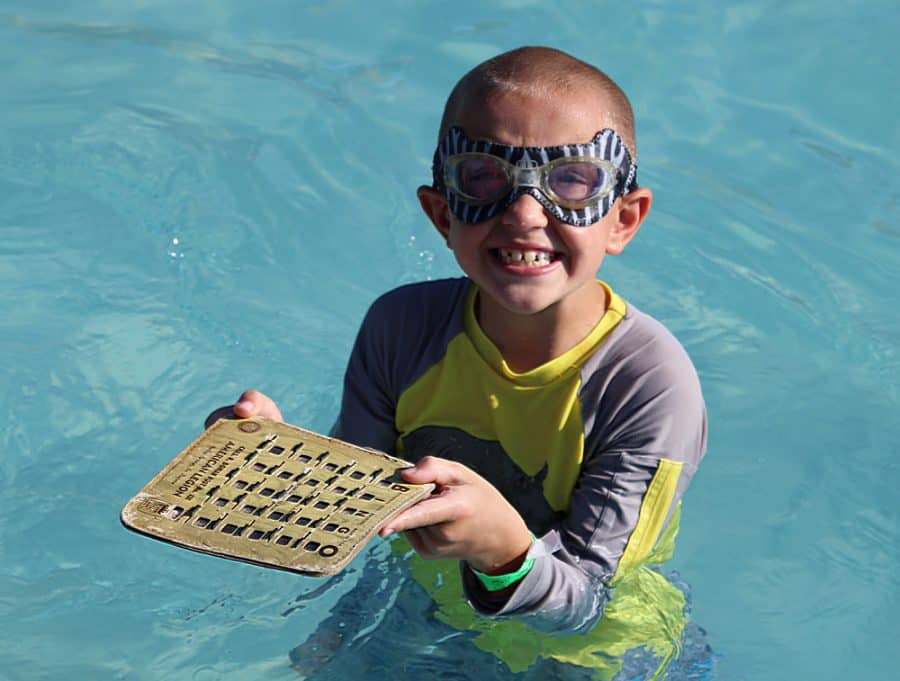 boy in pool - Jellystone - Top 10 Things To Do In Sioux Falls + The Best Place To Stay!
