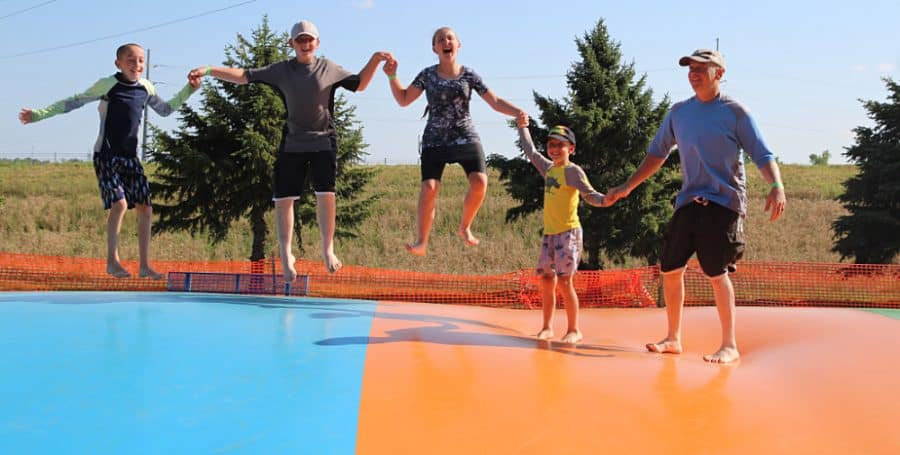 family on jumping pillow - Jellystone - Top 10 Things To Do In Sioux Falls + The Best Place To Stay!