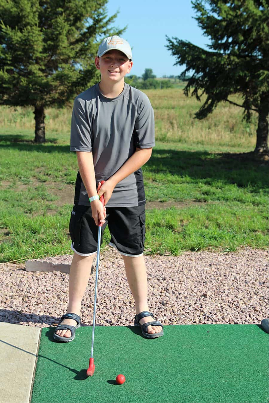 boy golfing - Jellystone - Top 10 Things To Do In Sioux Falls + The Best Place To Stay!