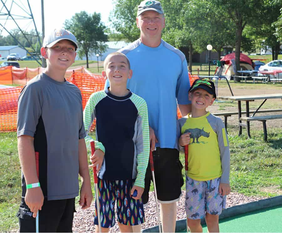 family mini golfing - Jellystone - Top 10 Things To Do In Sioux Falls + The Best Place To Stay!