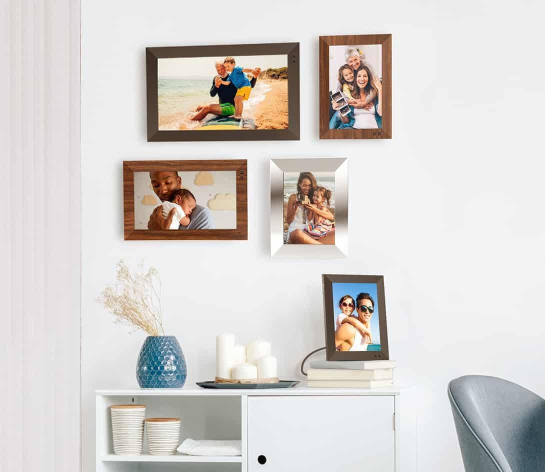 wall ith 4 digital photo frames and 1 on end table
