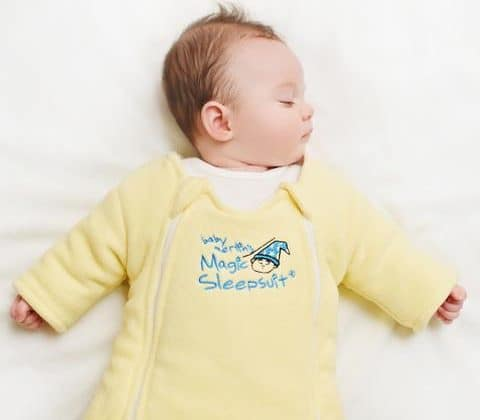 baby sleeping in magic sleep suit