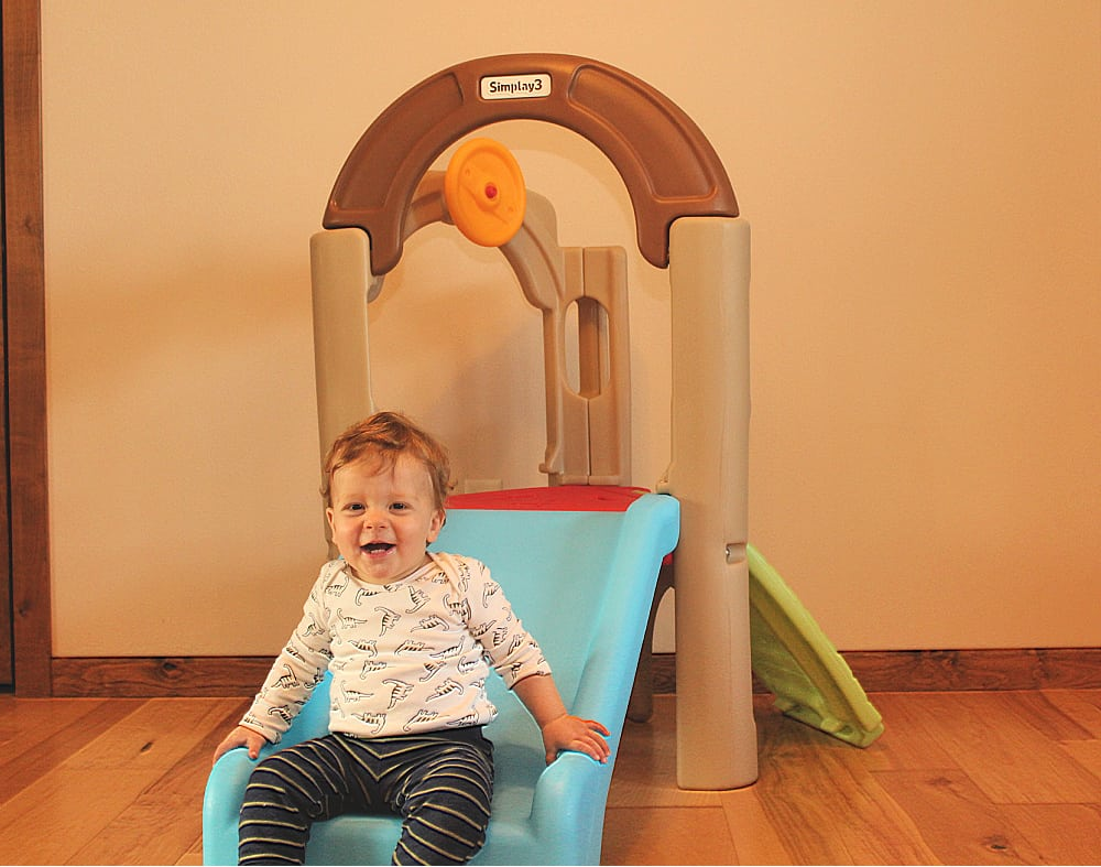toddler on activity climber