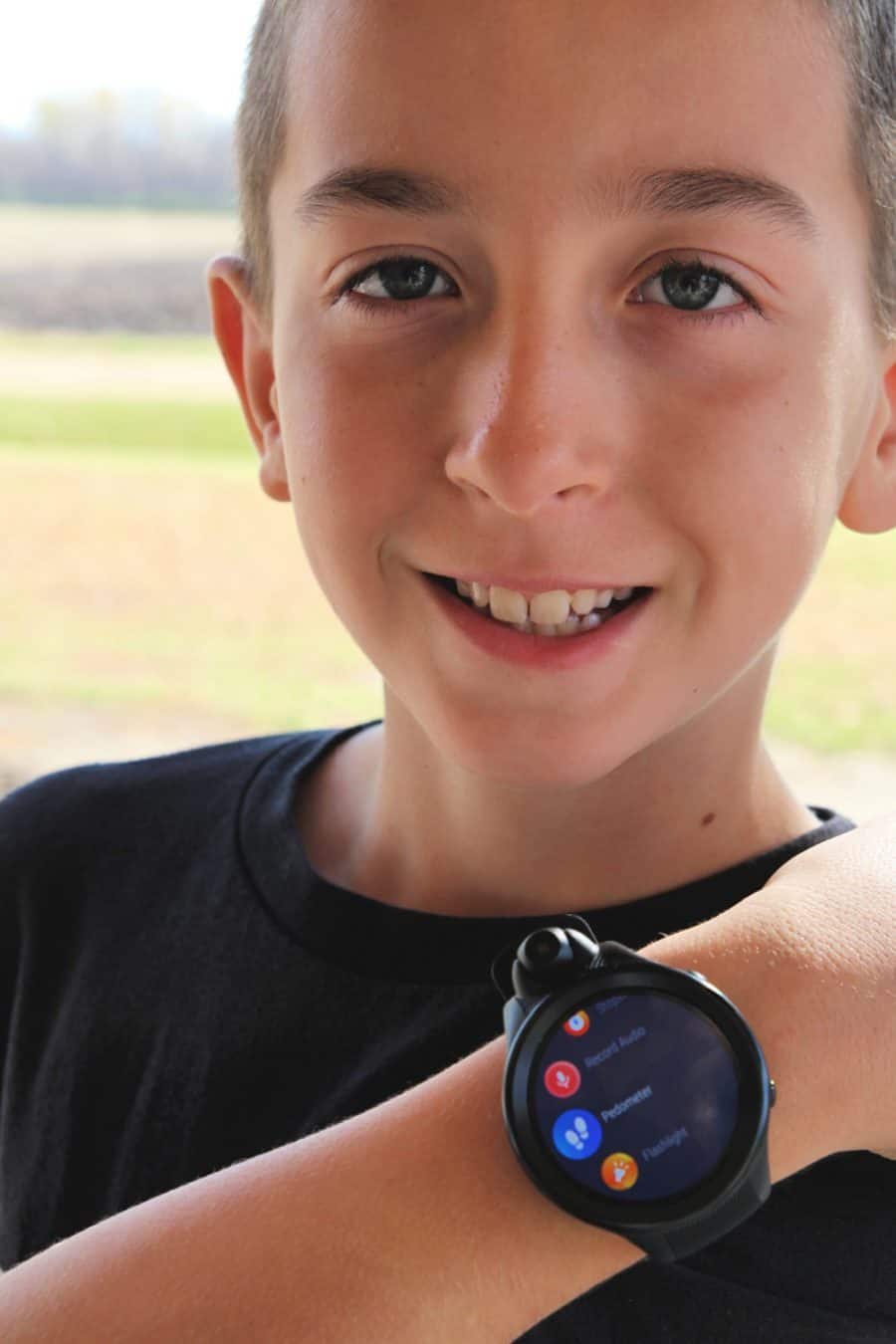 boy with smartwatch - Fennec Kids Smartwatch Review