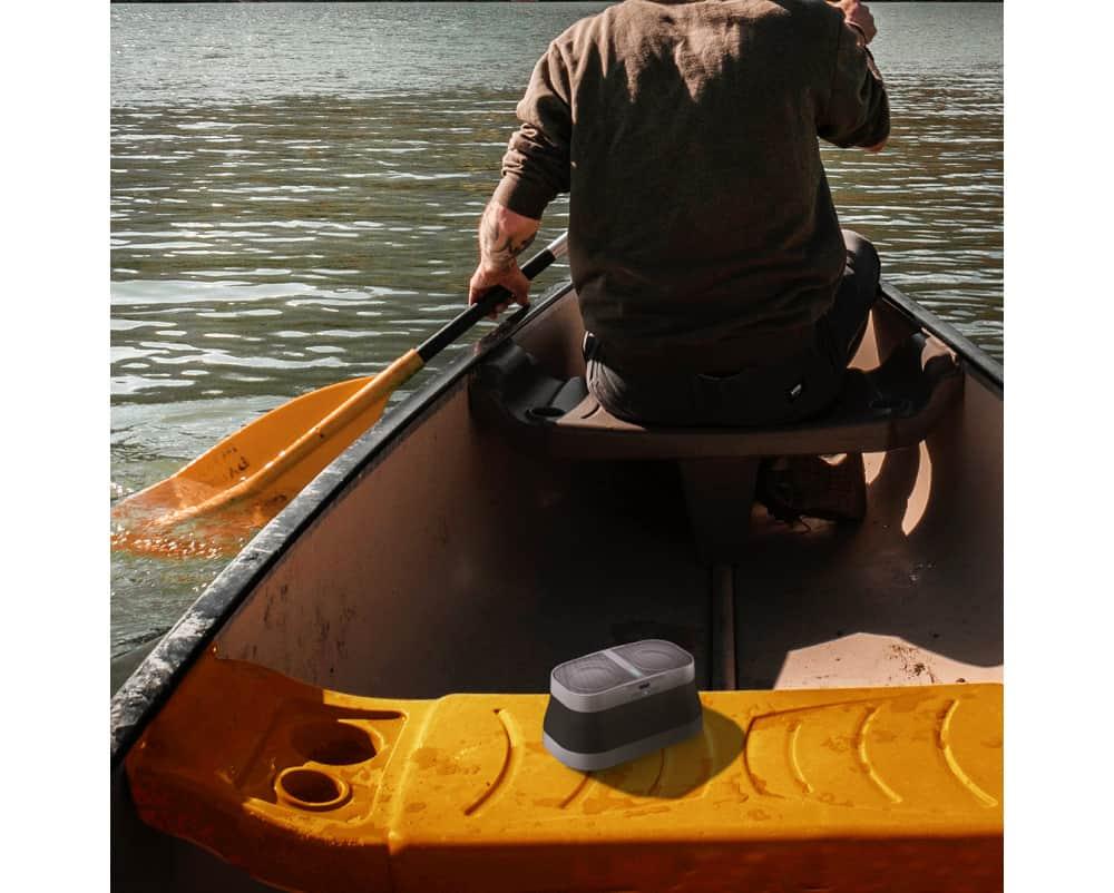 Man in boat with speaker