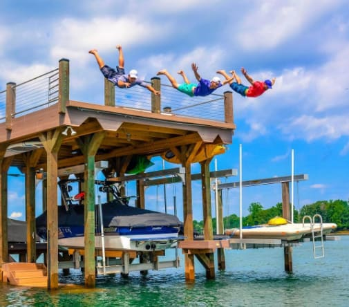 Jumping off dock - Rhoback Performance Polos Giveaway