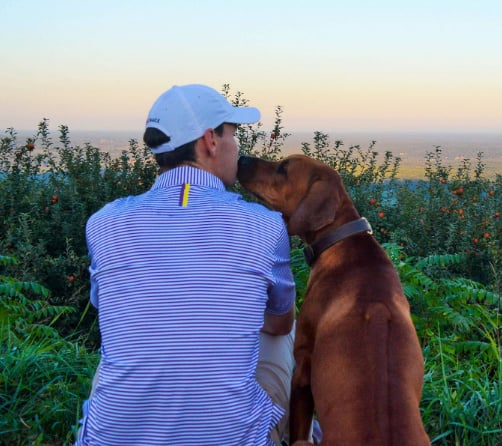 man and dog - Rhoback Performance Polos Giveaway