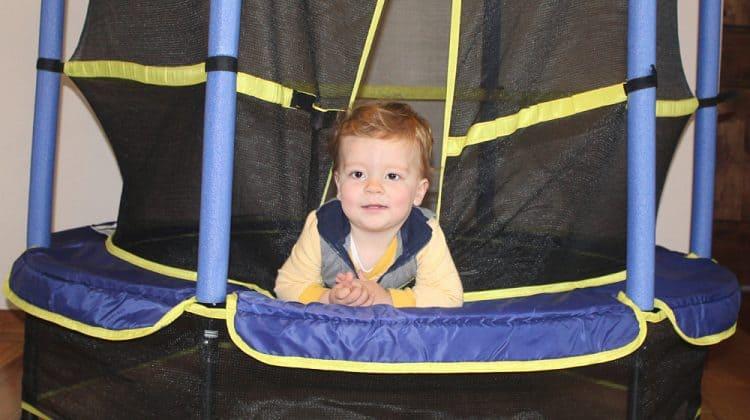 Toddler laying in trampoline