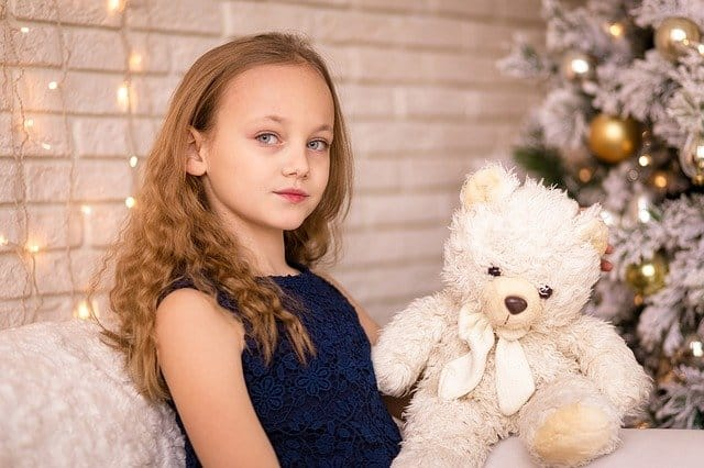 Girl with teddy - The Best Christmas Gifts For Kids Holiday Gift Guide