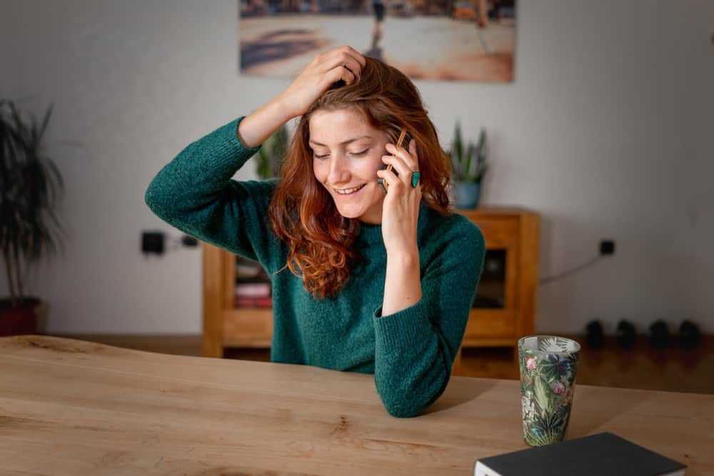 girl at the table on phone: The Best Gifts for Homemakers - Happy Homemaker