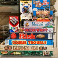 Stack of games for family game night - Winning Moves Games Giveaway
