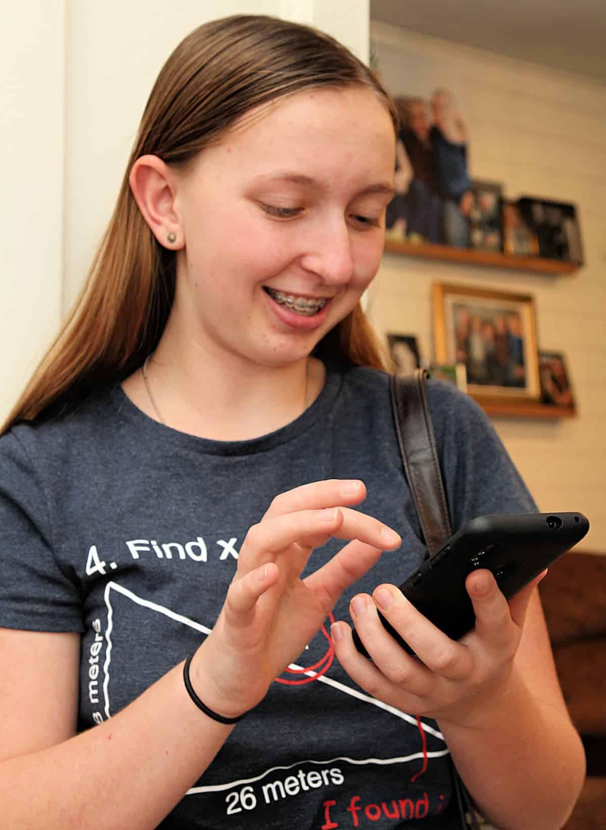teen girl on phone - Gabb Wireless Review + Discount Code