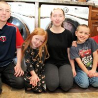 kids in laundry room - Family Laundry Tips - Whirlpool's Improving Life at Home Hub